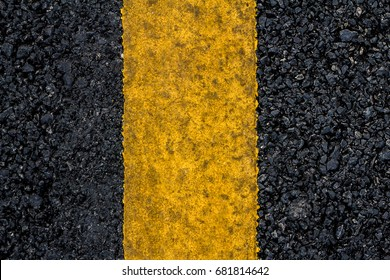 Closeup of an asphalt road texture with painted yellow line on the side, Top view of surface road, Old surface road for design and decorative workings