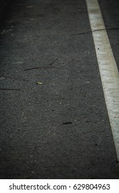 Closeup asphalt road with white line as abstract background