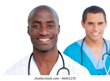 Close-up of assertive male doctors against a white background