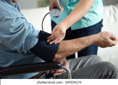 Close-up of assessment elderly patient's blood pressure
