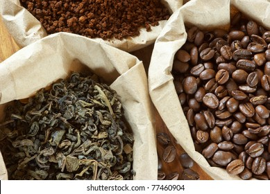 Close-up of assorted coffee and green tea in paper bags.