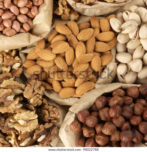 Close-up of assorted nuts in paper bags. Top view point.