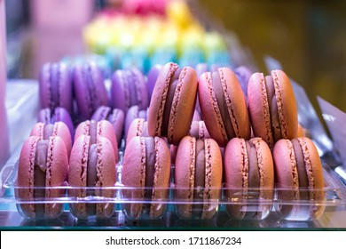 Close-up of assortment of french macarons on a tray for sale, indoors.