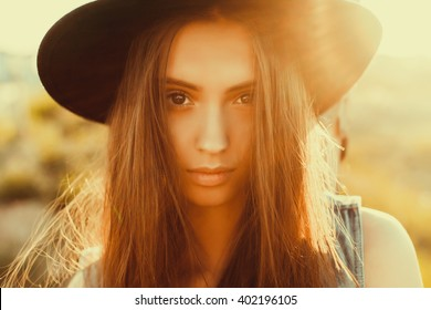 Closeup attractive beautiful woman with fluffy brunette long hairs,smiling, having fun on the park,wearing vintage ,outfit and hat,vacation style,autumn look,hairstyle,hairdresser, sad