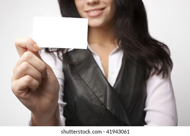 Closeup of attractive bussineswoman with bussines card