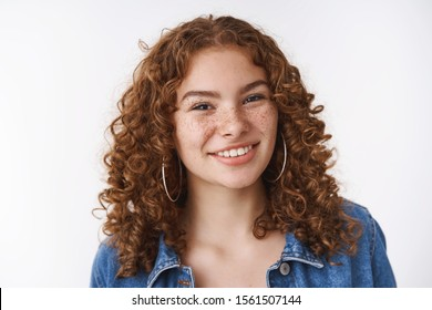 Close-up attractive confident smiling redhead curly-haired girl freckles acne prone skin unbothered pimples enjoy leading body-positive lifestyle, standing white background carefree