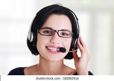 Closeup of attractive customer support representative smiling with headset