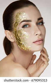 Closeup Of Attractive Sexy Girl With Hand Touching Body And Golden Mask On Face.