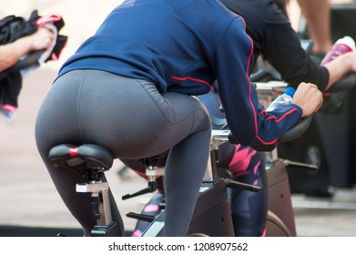 closeup of attractive woman on bike on group fitness classes demonstration in outdoor