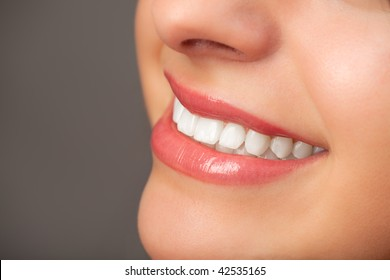 Close-up of an attractive woman's smile.