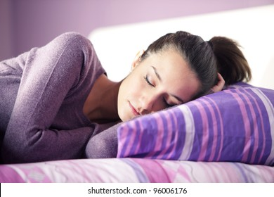 Close-up of an attractive young female sleeping in bed at home