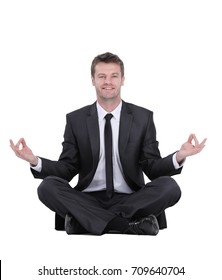 Closeup of attractive young man meditating isolated on white