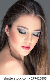 closeup of attractive young woman wearing sexy makeup posing