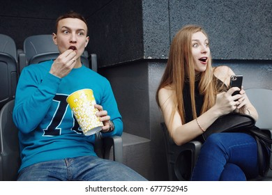 Close-up of the audience with popcorn