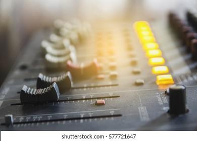 Closeup audio mixer slider in the control room.