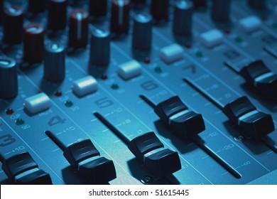 Closeup of audio mixing board focus of fader knob