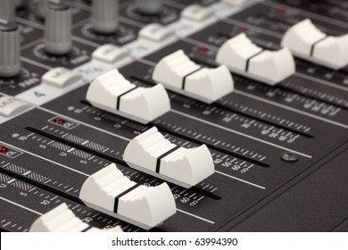 Closeup of audio mixing console. Shallow depth of field. Studio work.