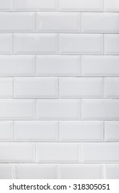Close-up of an authentic kitchen white tile wall.