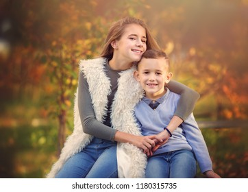 Closeup autumn portrait of cute brother with sister
