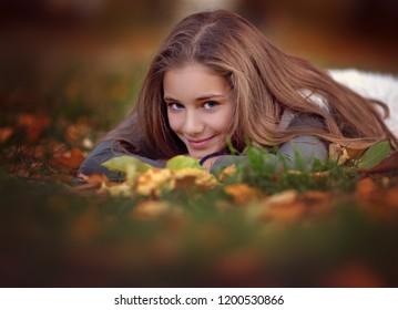 Closeup autumn portrait of cute girl outdoors