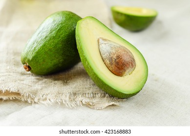 Close-up of an avocado on wooden table. Healthy food concept.