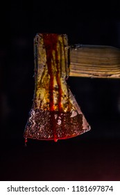 Close-up of axe dripping blood