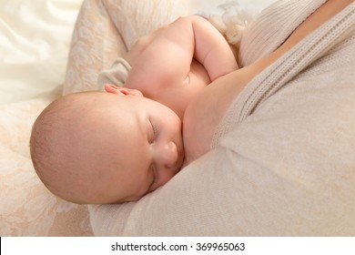 Closeup of a baby of 7 weeks old being breastfed