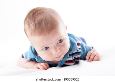 Close-up of a baby boy lying on the bed