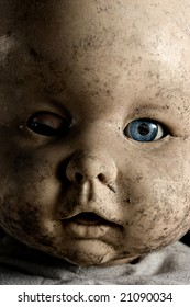 Close-up of baby doll with only on eye opened