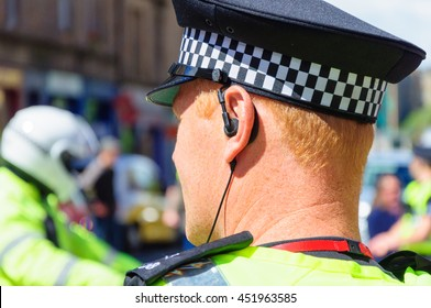 Closeup of the back of the head of a male officer of Police Scotland on duty in the city of Edinburgh