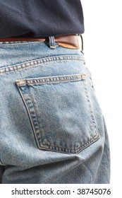 Closeup of the back pocket of a man wearing jeans, isolated on white.