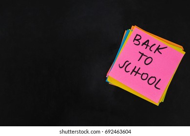 Close-up of back to school text written on sticky note