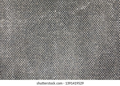 Close-up background of grey fabric or abstract black fabric texture. Black background.