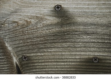 A close-up background photo of wood grain and screws in neutral tones.