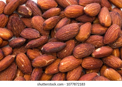 Closeup of a Background of Scattered Almonds