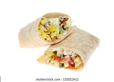 Closeup of bacon and salad bread wraps isolated against white