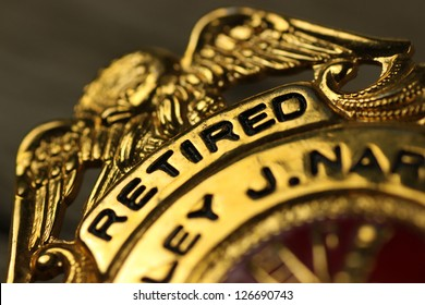 Closeup of a badge awarded to a civil servant
