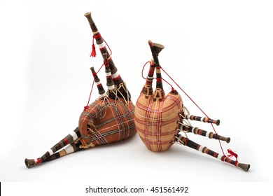 close-up of bagpipe from Scotland over white