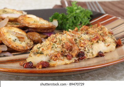 Closeup of a baked catfish fillet on a plate