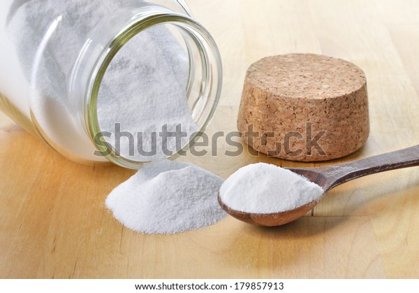 Close-up of baking soda in a glass jar. Bicarbonate of soda.