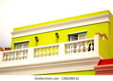 Close-up balcony of the yellow house in Bo-Kaap, Cape Town. South Africa. The British style colored building of the Muslim Malay Quarter. The vintage architecture.