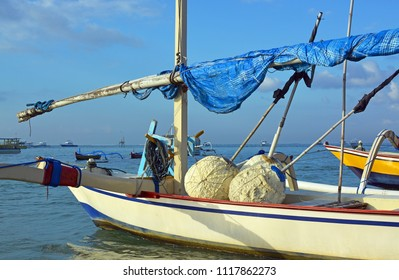 Closeup of Bali Outrigger fishing boat moored off Sanur Beach, Bali Indonesia