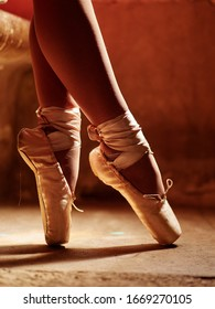 closeup of ballerina feet  in pointe shoes