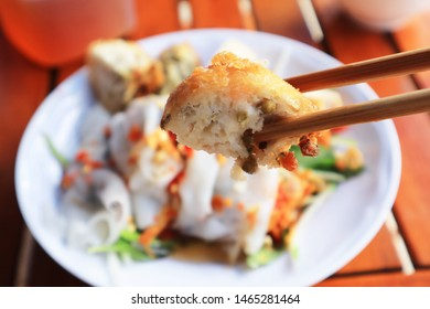 Closeup of Banh Tom (crispy fried shrimp cake) with Banh Cuon. Banh Cuon is a popular northern Vietnamese steamed rice rolls with ground pork and wood ear mushroom serves with sweet chili fish sauce.