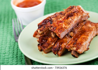 Closeup of barbecued pork ribs on a plate