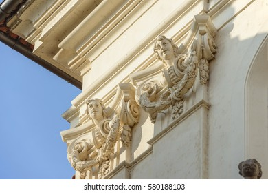 Close-up of Baroque entablature of early 18th century Church of St. Clement with capitals of corner pilasters on wall along Karlova Street in side sunlight, Prague, Czech Republic.