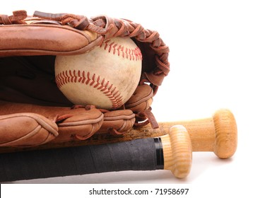 Closeup of a Baseball Glove, ball and two bats on white with copyspace. Horizontal format.