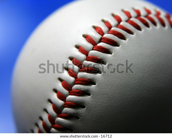 Closeup of baseball on blue background