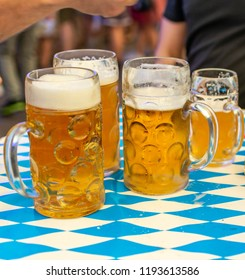 Close-up of bavarian beer glasses 1 liter Beer on table decoation at the Octoberfest