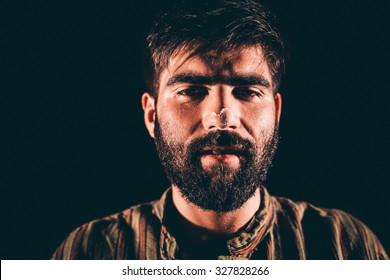 Closeup of a bearded junkie having hallucination